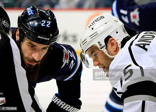 Chris Thorburn of the Winnipeg Jets and Andy Andreoff of the Los Angeles Kings get set for a first period faceoff at the MTS Centre on March 24 2016...