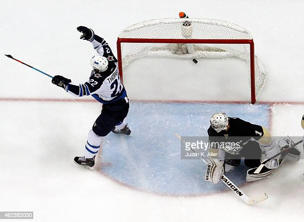 Chris Thorburn of the Winnipeg Jets celebrates after scoring past Thomas Greiss of the Pittsburgh Penguins during the game at Consol Energy Center on...