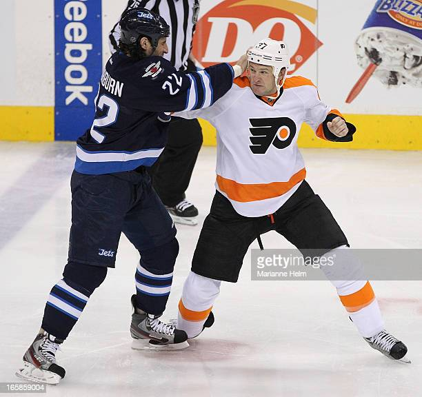 Chris Thorburn of the Winnipeg Jets fights with Jay Rosehill of the Philadelphia Flyers during third period in a game between the Winnipeg Jets and...