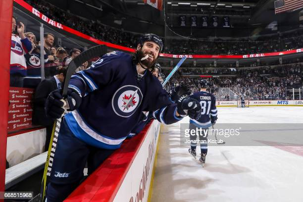 Chris Thorburn of the Winnipeg Jets is all smiles as teammate Kyle Connor celebrates his third period goal against the Nashville Predator at the...