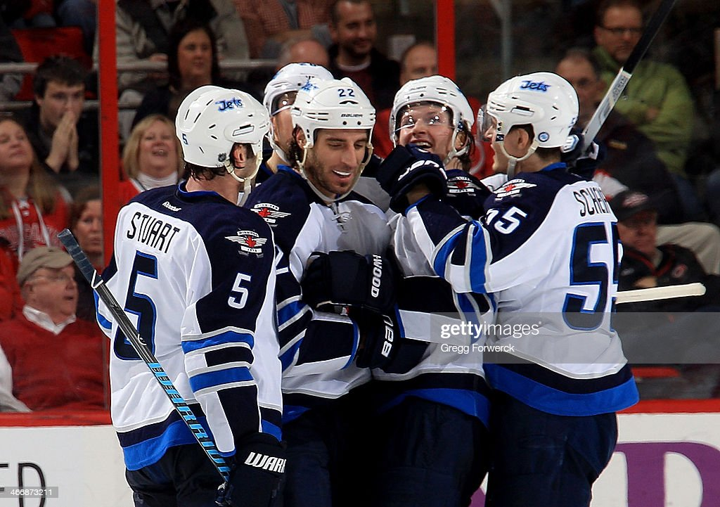 Chris Thorburn #22 of the Winnipeg Jets is congratulated by teammates on his game-winning goal after an NHL game against the Carolina Hurricanes at PNC Arena on February 4, 2014 in Raleigh, North Carolina.