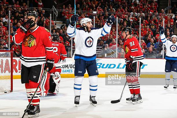 Chris Thorburn of the Winnipeg Jets reacts after scoring against the Chicago Blackhawks in the third period during the NHL game at the United Center...