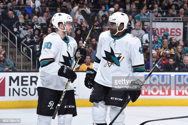Chris Tierney and Joel Ward of the San Jose Sharks converse during a game against the Los Angeles Kings at STAPLES Center on January 15 2018 in Los...