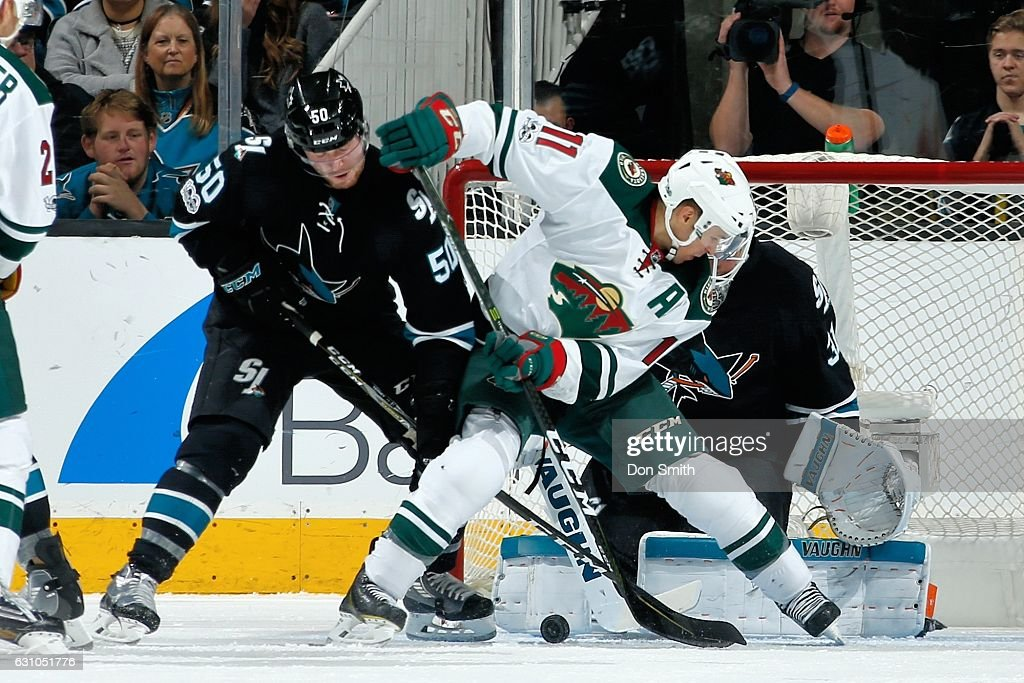 Chris Tierney #50 and Martin Jones #31of the San Jose Sharks defend against Zach Parise #11 of the Minnesota Wild during a NHL game at SAP Center at San Jose on January 5, 2017 in San Jose, California.