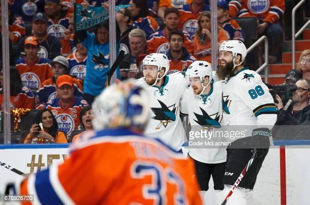 Chris Tierney Mikkel Boedker and Brent Burns of the San Jose Sharks celebrate Boedker's goal against the Edmonton Oilers in Game Five of the Western...