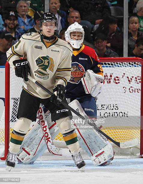 Chris Tierney of the London Knights waits for a shot to tip in front of Oscar Dansk of the Erie Otters in an OHL game on September 21 2012 at the...