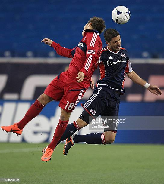 Chris Tierney of the New England Revolution battles Chris Rolfe of the Chicago Fire for control of the ball at Gillette Stadium on June 2 2012 in...