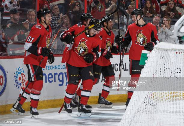 Chris Tierney of the Ottawa Senators celebrates his first period goal against the Los Angeles Kings with teammates Mark Stone Dylan DeMelo and Brady...