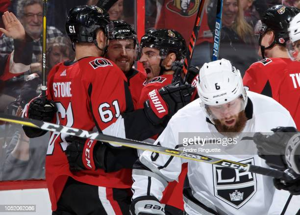 Chris Tierney of the Ottawa Senators celebrates his first period goal with teammates Mark Stone and Dylan DeMelo as Jake Muzzin of the Los Angeles...