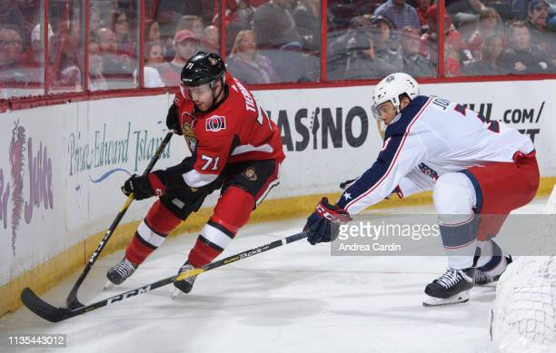 Chris Tierney of the Ottawa Senators stickhandles the puck against Seth Jones of the Columbus Blue Jackets at Canadian Tire Centre on April 6 2019 in...
