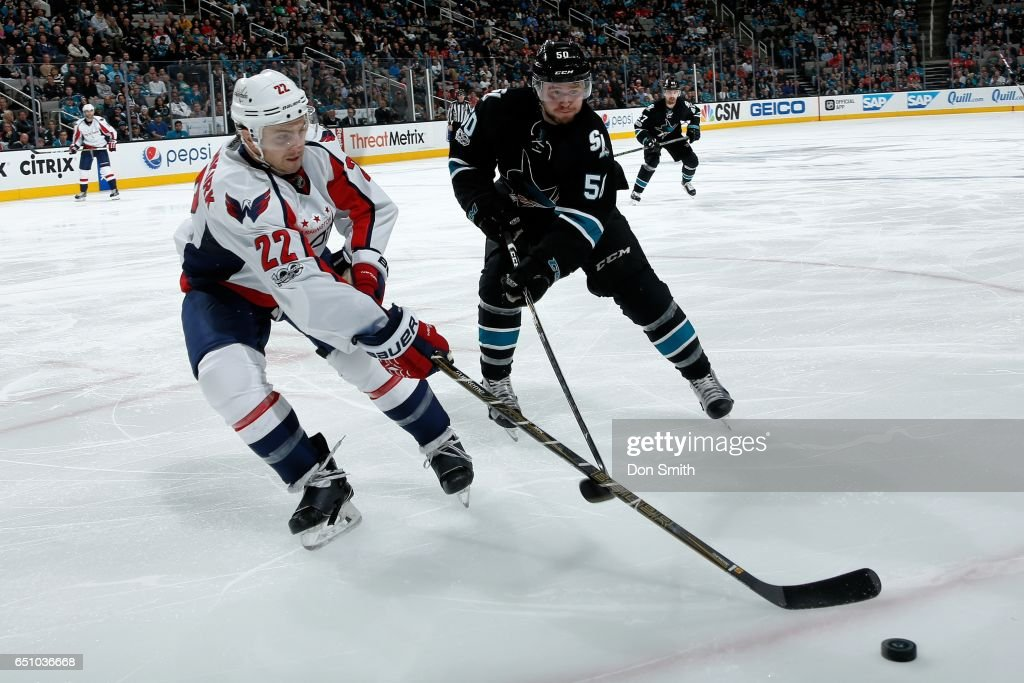 Chris Tierney #50 of the San Jose Sharks and Kevin Shattenkirk #22 of the Washington Capitals battle for the puck along the boards at SAP Center at San Jose on March 9, 2017 in San Jose, California.
