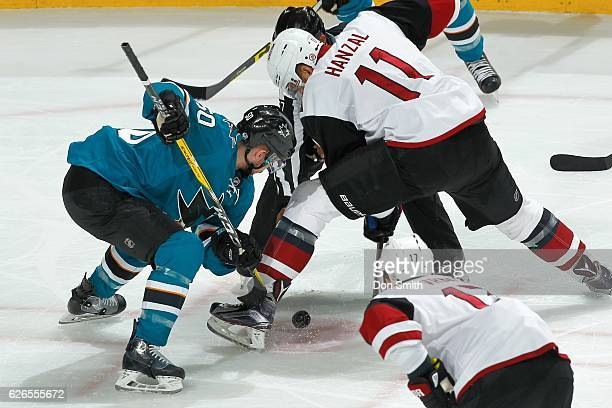 Chris Tierney of the San Jose Sharks and Martin Hanzal of the Arizona Coyotes face off during a NHL game at SAP Center at San Jose on November 29,...