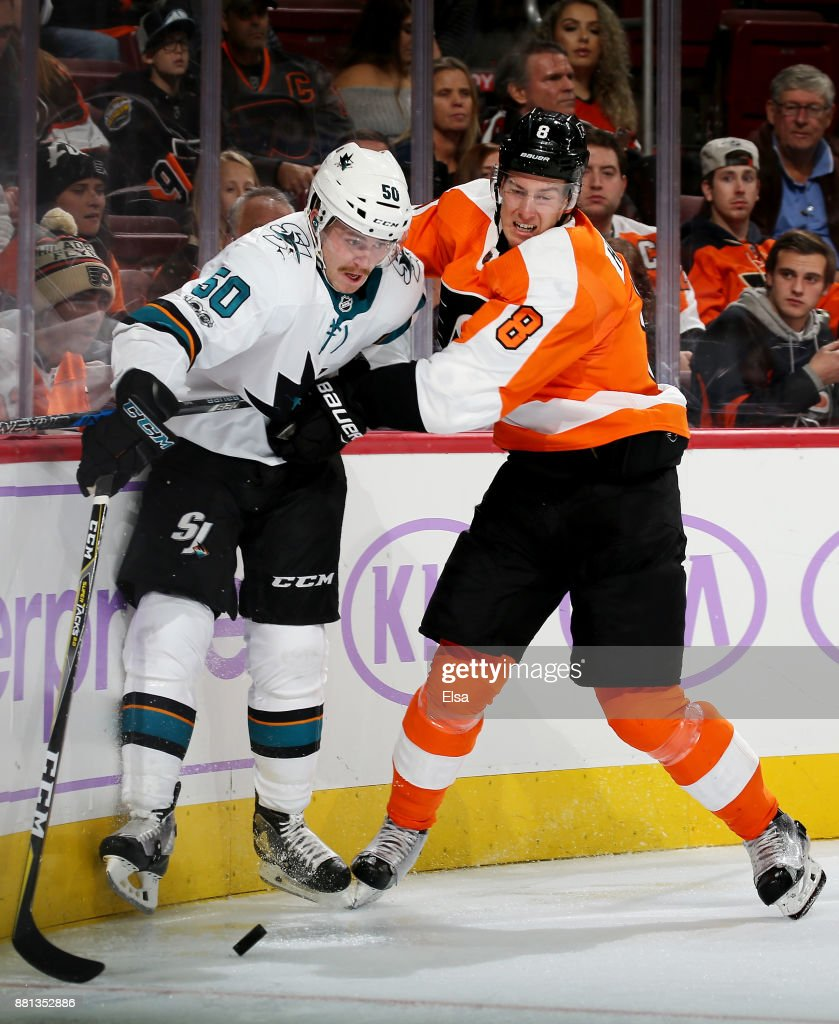 Chris Tierney #50 of the San Jose Sharks and Robert Hagg #8 of the Philadelphia Flyers fight for the puck in the third period on November 28, 2017 at Wells Fargo Center in Philadelphia, Pennsylvania.