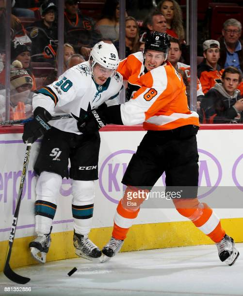 Chris Tierney of the San Jose Sharks and Robert Hagg of the Philadelphia Flyers fight for the puck in the third period on November 28 2017 at Wells...