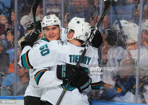 Chris Tierney of the San Jose Sharks celebrates his second period goal with Timo Meier during an NHL game against the Buffalo Sabres on October 28...