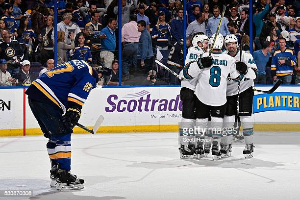 Chris Tierney of the San Jose Sharks celebrates with Joe Pavelski and MarcEdouard Vlasic after scoring his second goal of the game as Alex...