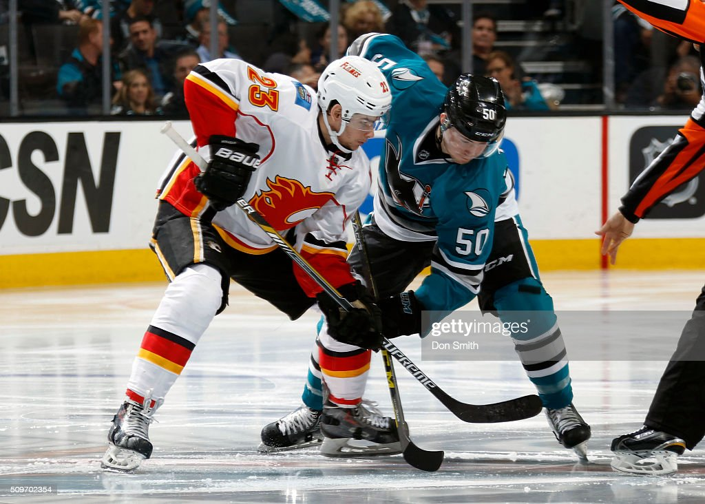 Chris Tierney #50 of the San Jose Sharks faces-off against Sean Monahan #23 of the Calgary Flames during a NHL game at the SAP Center at San Jose on February 11, 2016 in San Jose, California.