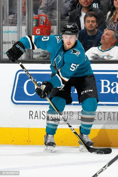 Chris Tierney of the San Jose Sharks handles the puck during a NHL game against the Arizona Coyotes at SAP Center on February 13 2018 in San Jose...