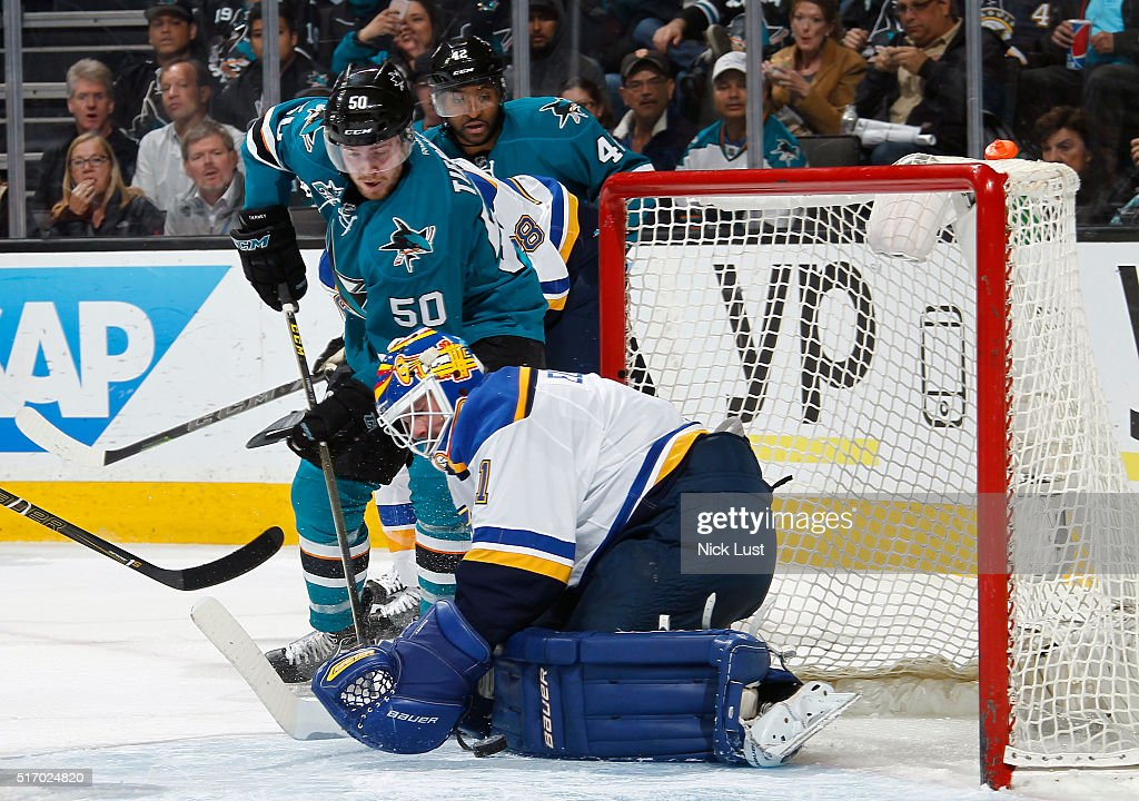 Chris Tierney #50 of the San Jose Sharks has his rebound shot blocked against Brian Elliott #1 of the St. Louis Blues during a NHL game at the SAP Center at San Jose on March 22, 2016 in San Jose, California.