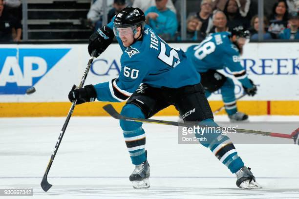 Chris Tierney of the San Jose Sharks passes the puck during a NHL game against the Washington Capitols at SAP Center on March 10 2018 in San Jose...