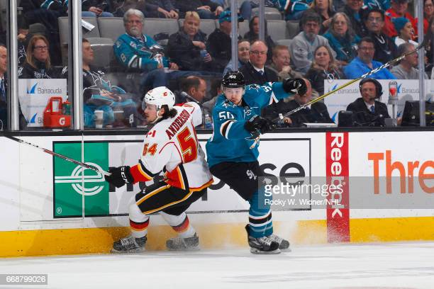 Chris Tierney of the San Jose Sharks skates against Rasmus Andersson of the Calgary Flames at SAP Center on April 8 2017 in San Jose California