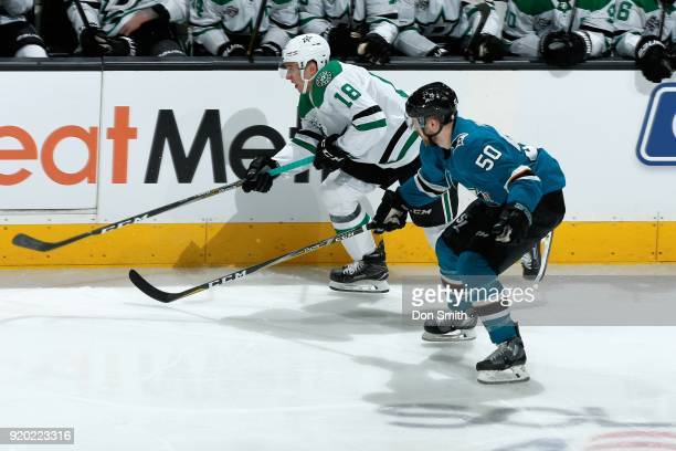 Chris Tierney of the San Jose Sharks skates against Tyler Pitlick of the Dallas Stars at SAP Center on February 18 2018 in San Jose California