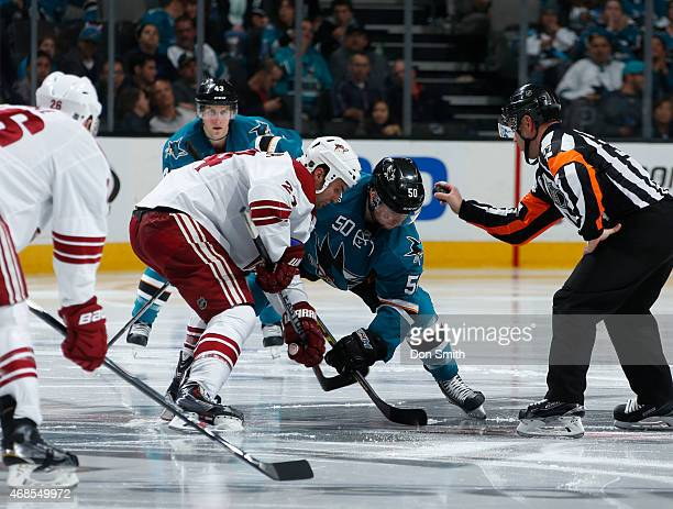Chris Tierney of the San Jose Sharks takes a faceoff against Jordan Szwarz of the Arizona Coyotes at the SAP Center on April 3 2015 in San Jose...