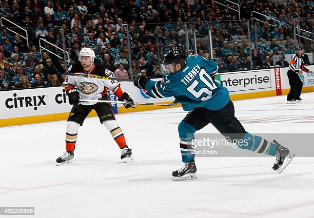Chris Tierney of the San Jose Sharks takes a shot on net against Jiri Sekac of the Anaheim Ducks during a NHL game at the SAP Center at San Jose on...