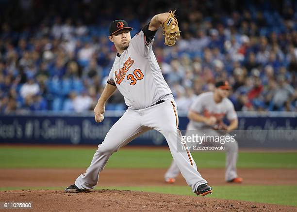 Chris Tillman of the Baltimore Orioles delivers a pitch in the first inning during MLB game action against the Toronto Blue Jays on September 28 2016...