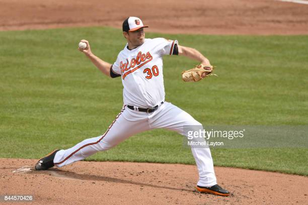 Chris Tillman of the Baltimore Orioles pitches during a baseball game against the Toronto Blue Jays at Oriole Park at Camden Yards on September 3...