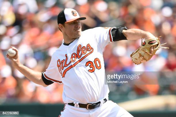 Chris Tillman of the Baltimore Orioles pitches in the first inning during a baseball game against the Toronto Blue Jays at Oriole Park at Camden...