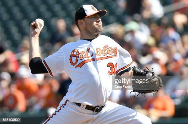 Chris Tillman of the Baltimore Orioles pitches in the first inning against the Tampa Bay Rays at Oriole Park at Camden Yards on September 24 2017 in...