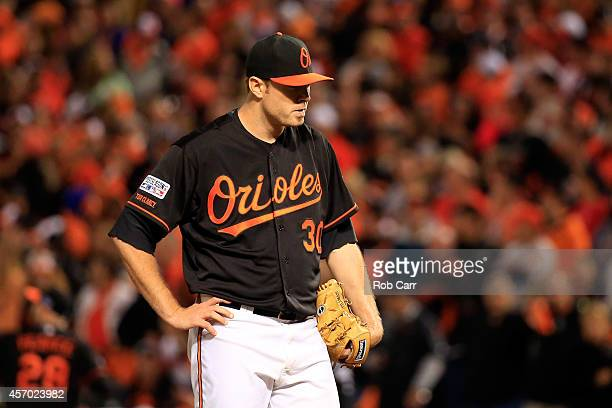 Chris Tillman of the Baltimore Orioles reacts after giving up a home run to Alcides Escobar of the Kansas City Royals in the third inning during Game...
