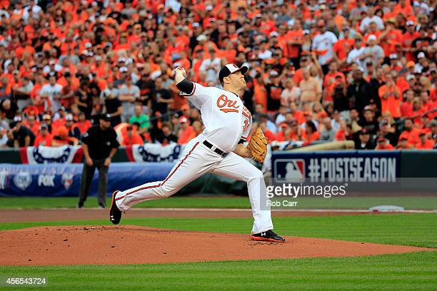 Chris Tillman of the Baltimore Orioles throws a pitch in the first inning against against the Detroit Tigers during Game One of the American League...