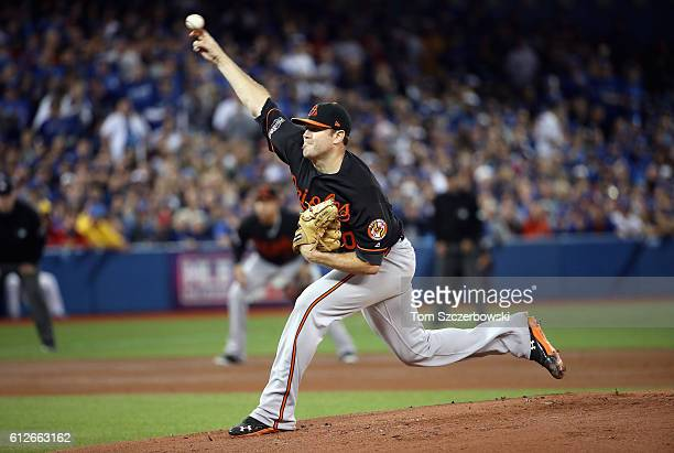 Chris Tillman of the Baltimore Orioles throws a pitch in the first inning against the Toronto Blue Jays during the American League Wild Card game at...