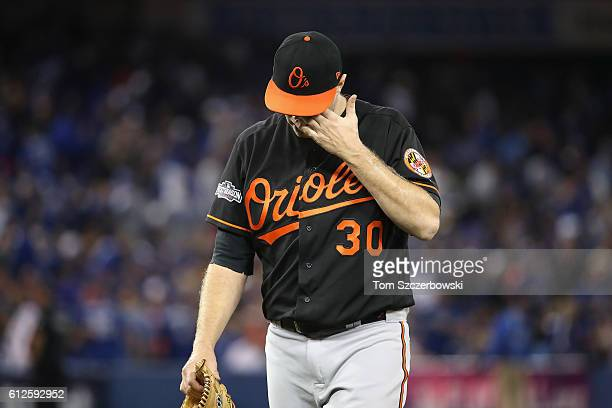 Chris Tillman of the Baltimore Orioles walks back to the dugout after the second inning against the Toronto Blue Jays during the American League Wild...