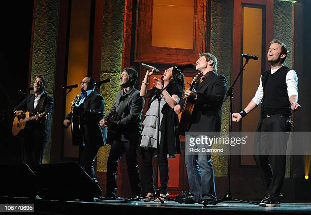 Chris Tomlin Michael W Smith Israel Houghton Paul Baloche and Christy Nockles perform onsatge at the 39th Annual GMA Dove Awards held at the Grand...