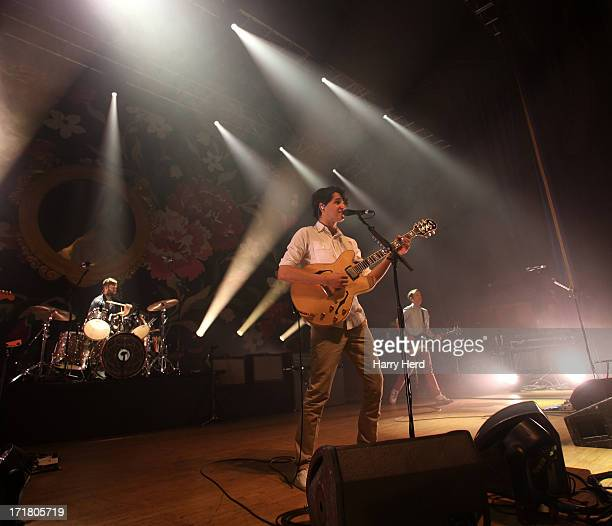 Chris Tomson Ezra Koenig and Chris Baio of Vampire Weekend perform on stage at Portsmouth Guildhall on June 28 2013 in Portsmouth England