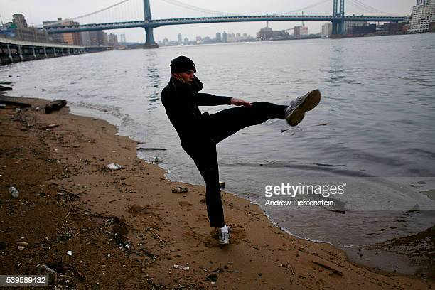 Chris trains for a fight along the banks of the East River Christopher Kwiatkowski is a real estate manager and developer by day and a Muay Thai...