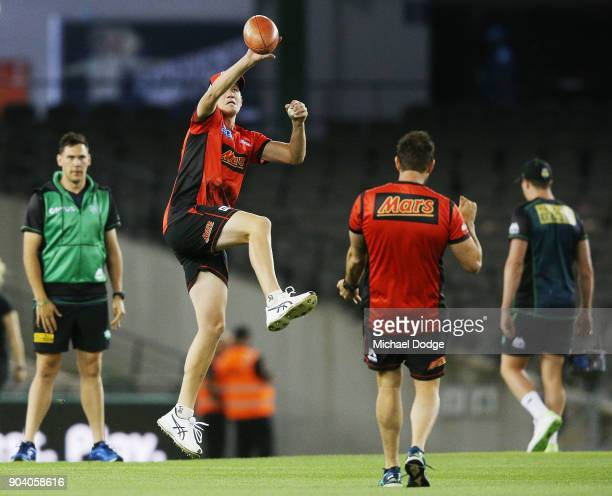 Chris Tremain of the Renegades catches a football during the Big Bash League match between the Melbourne Renegades and the Melbourne Stars at Etihad...