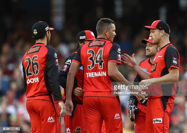 Chris Tremain of the Renegades celebrates the wicket of Jake Weatherald of the Strikers during the Big Bash League match between the Melbourne...