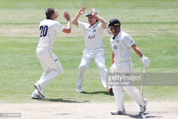 Chris Tremain of Victoria and Will Pucovski celebrate the wicket of Hilton Cartwright of Western Australia during day four of the Sheffield Shield...