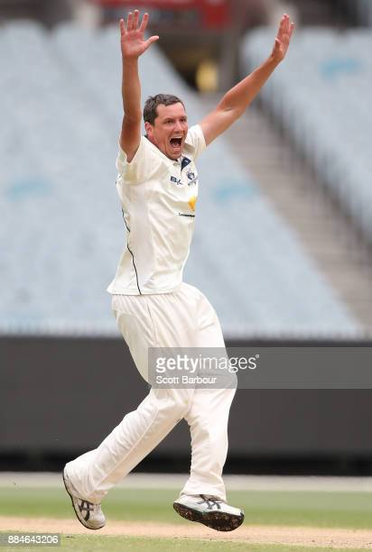 Chris Tremain of Victoria appeals successfully to dismiss Josh Inglis of Western Australia during day one of the Sheffield Shield match between...