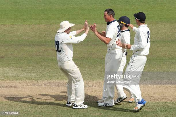 Chris Tremain of Victoria ceelebrates the wicket of Kurtis Patterson of NSW during day four of the Sheffield Shield match between New South Wales and...