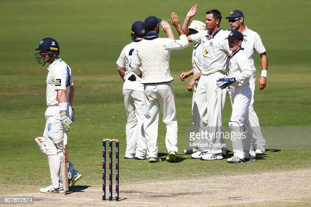 Chris Tremain of Victoria celebrates a wicket during day five of the Sheffield Shield match between Victoria and New South Wales at Junction Oval on...