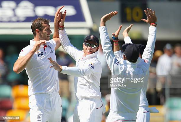 Chris Tremlett of England celebrates with Ian Bell of the England after taking the wicket of Steve Smith of Australia during day one of the First...