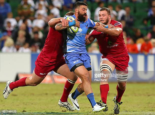 Chris Tuatara-Morrison of the Force gets tackled by James Slipper and Curtis Browning of the Reds during the round 18 Super Rugby match between the...