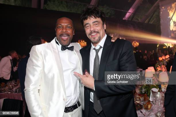 Chris Tucker and Benicio del Toro attend the amfAR Gala Cannes 2018 dinner at Hotel du CapEdenRoc on May 17 2018 in Cap d'Antibes France