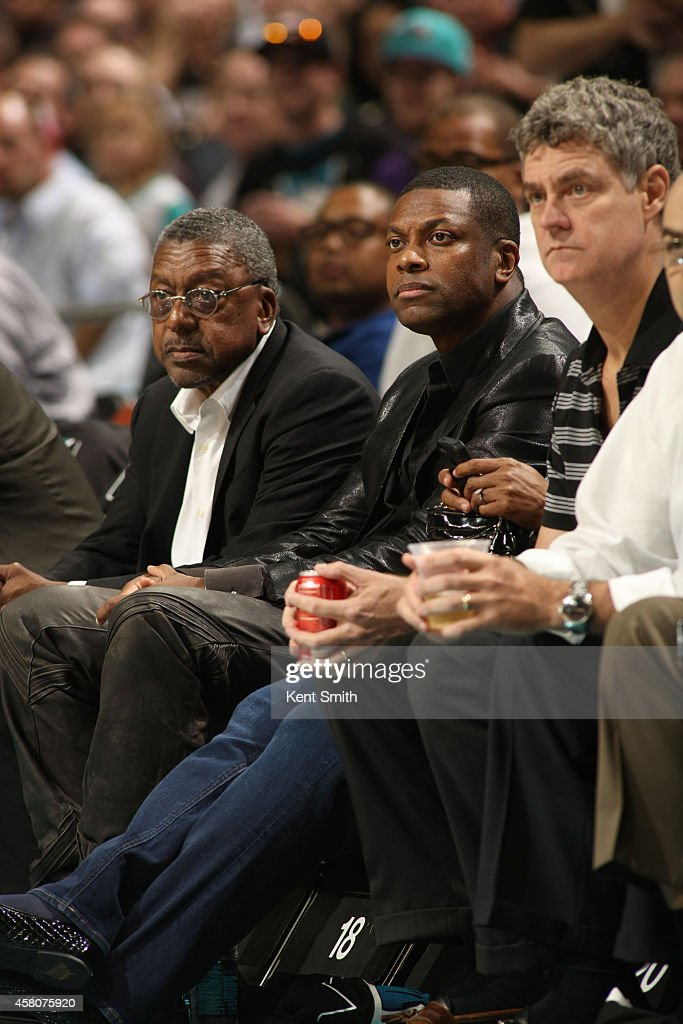 Chris Tucker and Bob Johnson watch the game between the Charlotte Hornets and the Milwaukee Bucks at the Time Warner Cable Arena on October 29, 2014 in Charlotte, North Carolina.