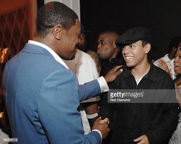 Chris Tucker and Evan Ross Son of Diana Ross Celebrate Chris Tucker's new film Rush Hour 3 At his afterparty at Atlanta's Dolce in Atlantic Station...